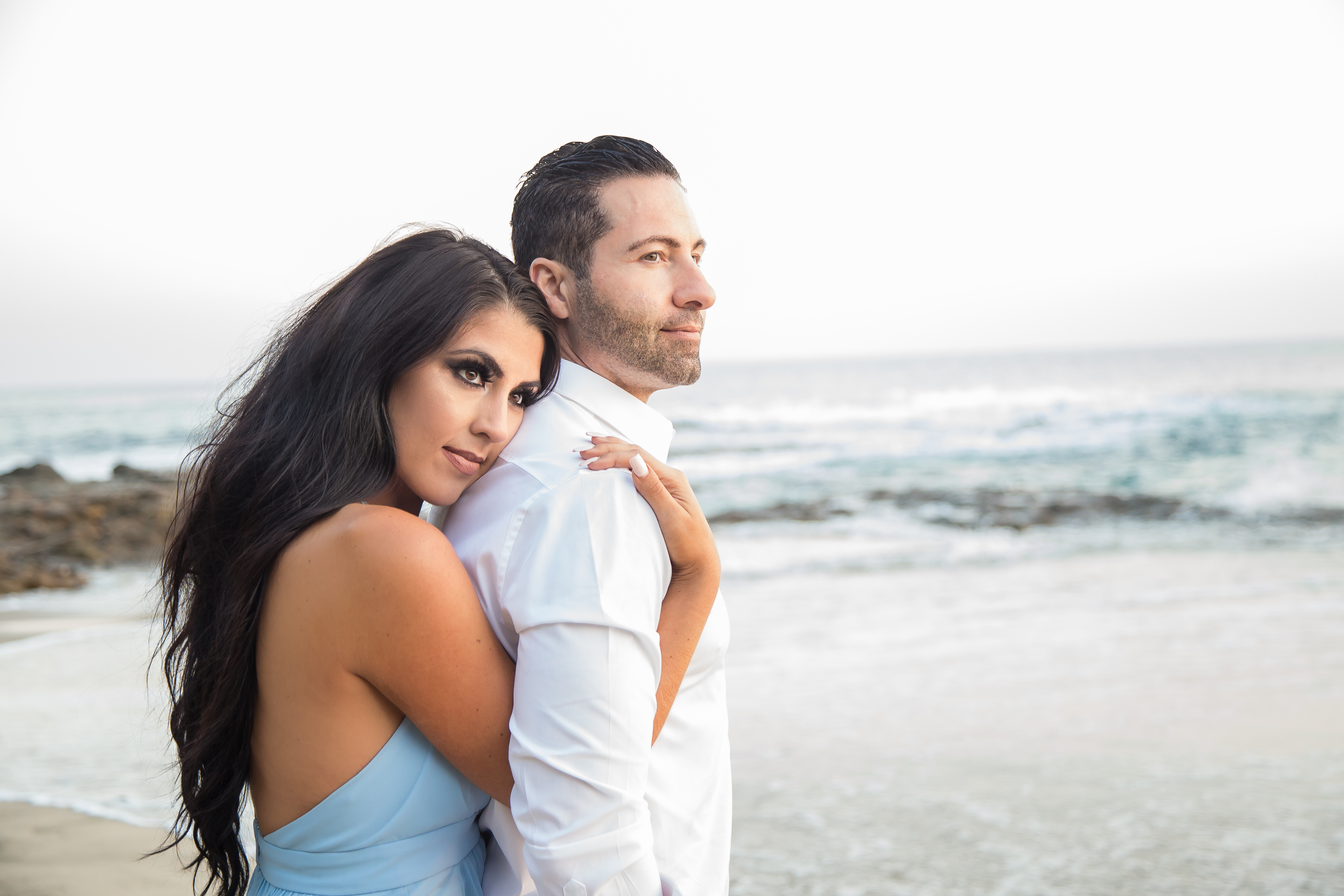 photo style image engagement on the beach